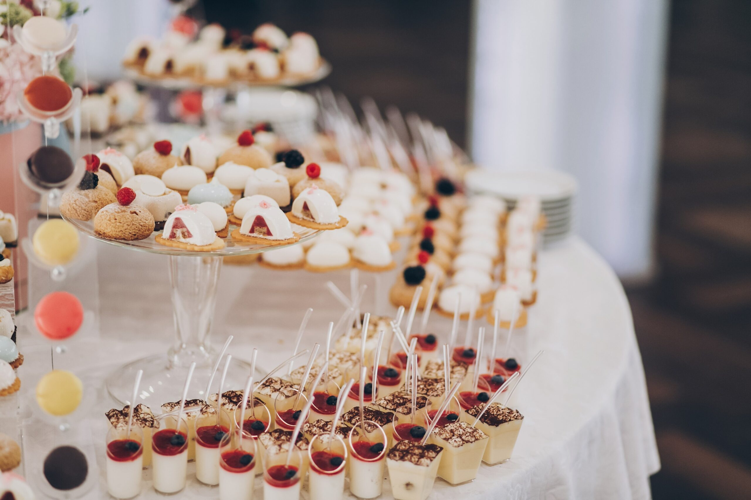 Wedding candy bar Delicious creamy desserts with fruits, panna cotta, cakes and cookies